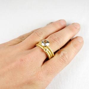 """Anton: 750/- Gelbgold mit Topas weiß; Ring 750/- gelb; Pünktchen: 750/- Gelbgold mit Brillant """"champagner"""""""